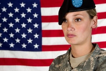 woman soldier with American flag background